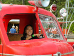 Claire driving the old fire truck at Remlinger Farms.