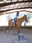 Claire riding Cookie on Gotcha Day (Aug. 17, 2010). Mommy and Daddy took her for a horse-riding lesson.