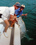 In Key West, FL with an 85 lb. tarpon taken on 12 lb. test. June 1993.